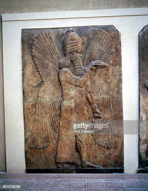 Assyrian relief of a winged genie with a bucket and a cedar cone making a liberation Palace of Sargon II Khorsabad 8th century BC Part of the...