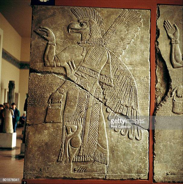 Assyrian relief of Winged genie carrying a cedarcone In the collection at the Pergamon Museum in Berlin