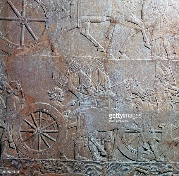 Assyrian relief showing an Assyrian chariot at the battle of the river Ulai from the north palace of Ashurbanipal at Ninevah from the British...