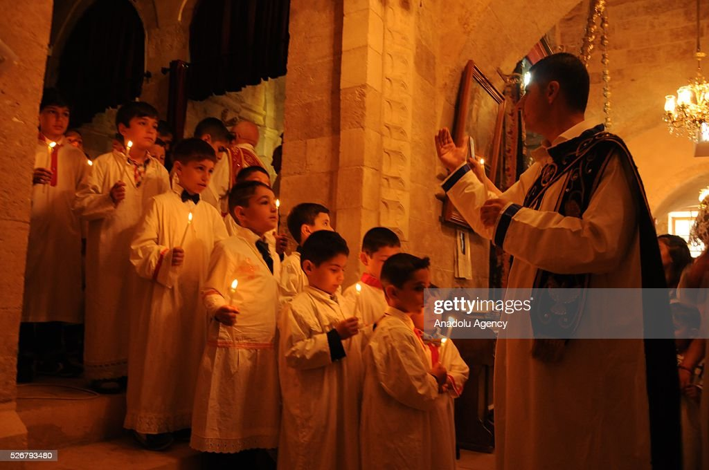 Assyrians attend the Easter Mass at Kirklar Church in Mardin, southeastern city of Turkey on May 1, 2016.