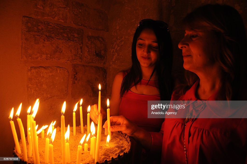 Assyrians light candles during the Easter Mass at Kirklar Church in Mardin, southeastern city of Turkey on May 1, 2016.