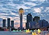 New centre of Astana capital city of Kazakhstan with landmark Baiterek tower at sunset