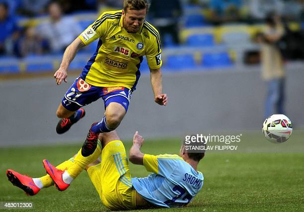 FC Astana midfielder Dmitri Shomko vies with HJK Helsinki defender Sebastian Sorsa during the second leg football match between FC Astana and HJK...