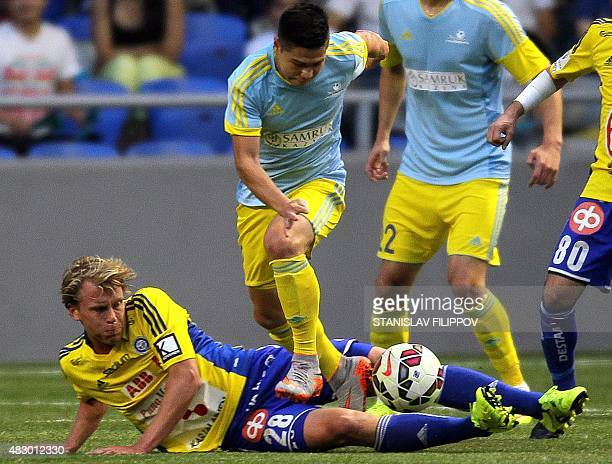 FC Astana midfielder Georgy Zhukov vies with HJK Helsinki midfielder Rasmus Scheuller during the second leg football match between FC Astana and HJK...