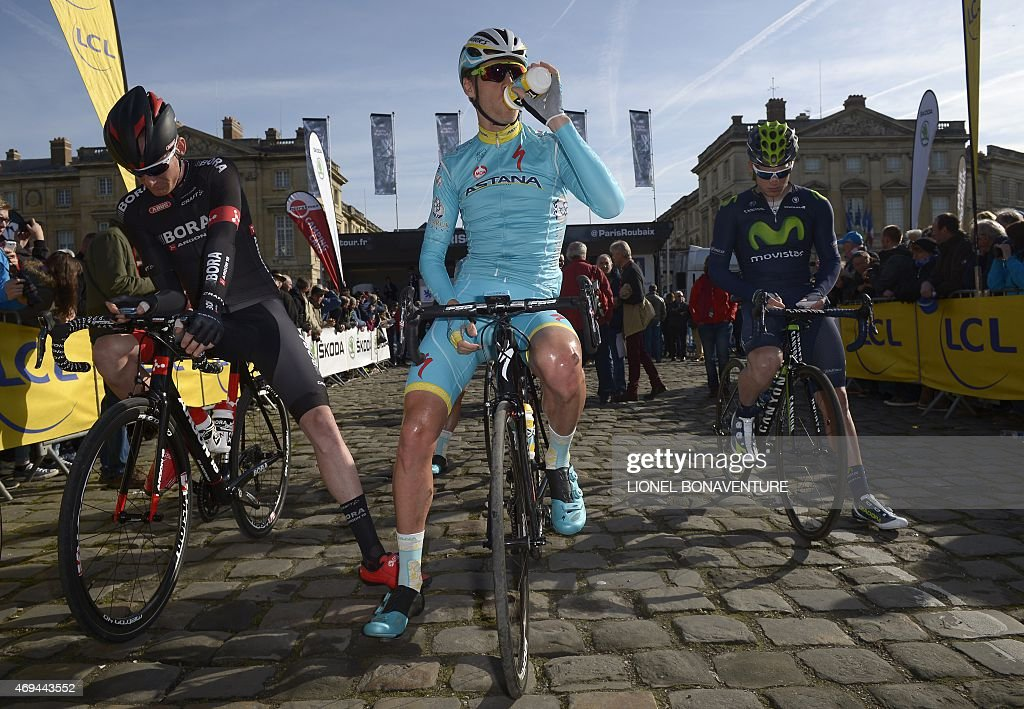 Astana Pro Team Dutch cyclist <a gi-track='captionPersonalityLinkClicked' href=/galleries/search?phrase=Lars+Boom&family=editorial&specificpeople=2696194 ng-click='$event.stopPropagation()'>Lars Boom</a> (C) waits for the start of the 113th edition of the Paris-Roubaix Paris-Roubaix one-day classic cycling race at the starting point in Compiègne on April 12, 2015.