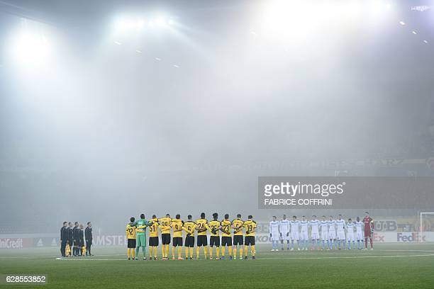 TOPSHOT Astana's and Young Boys' players observe a minute of silence in memory of the football players of the Brazilian team Chapecoense killed...