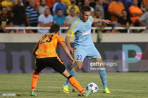 Astana's Baurzhan Dzholchiyev and Apoel's Inaki Astiz in action during UEFA Champions League play off between APOEL Nicosia and FC Astana at GSP...