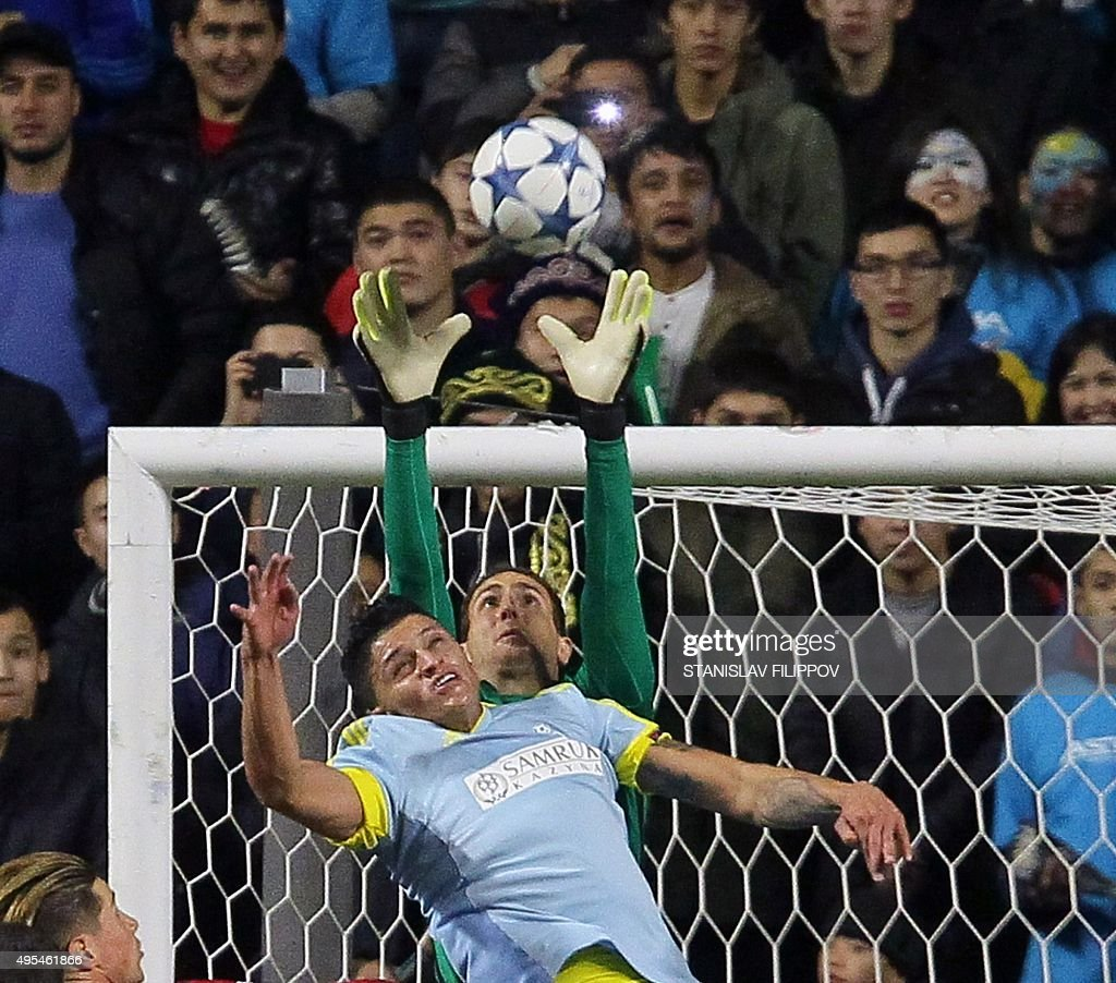 Astana's Colombian midfielder Roger Henao Canas vies for the ball with Atletico Madrid's Slovenian goalkeeper Jan Oblak during the UEFA Champions...