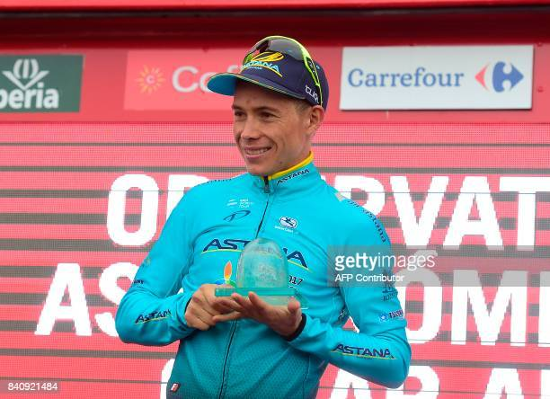 Astana's Colombian Miguel Angel Lopez celebrates on the podium after winning the 11th stage during the 72nd edition of 'La Vuelta' Tour of Spain...