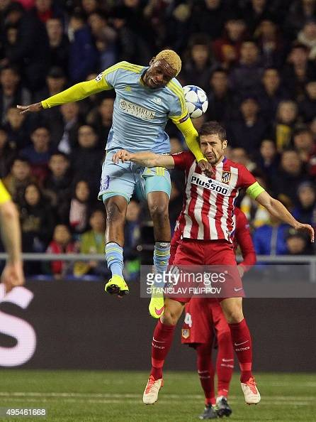 Astana's Congolese forward Junior Kabananga vies for the ball with Atletico Madrid's midfielder Gabi during the UEFA Champions League group C...