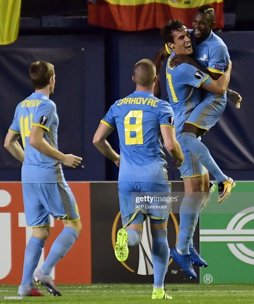 Astana's defender from Kazakhstan Yuri Logvinenko (2R) celabrates his gaol with Astana's forward from Ghana Patrick Twumasi during the Europa League football match Villarreal CF vs FC Astana at La Ceramica stadium in Vila-real on September 14, 2017. /