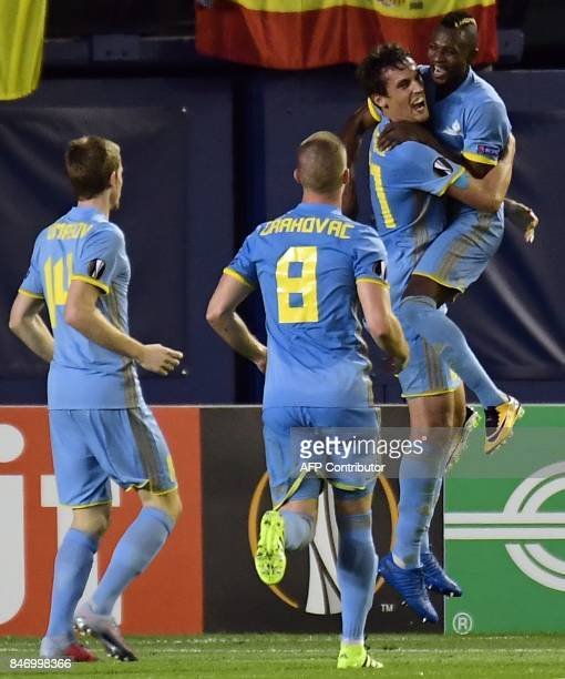 Astana's defender from Kazakhstan Yuri Logvinenko celabrates his gaol with Astana's forward from Ghana Patrick Twumasi during the Europa League...