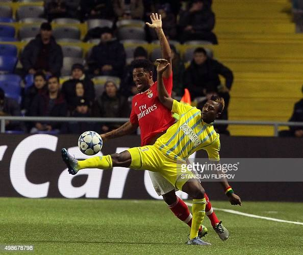 Astana's Ghanaian forward from Ghana Patrick Twumasi vies for the ball with Benfica's defender Eliseu during the UEFA Champions League group C...