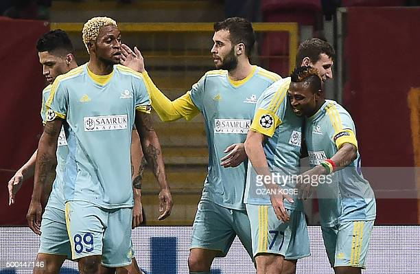 Astana's Ghanaian forward Patrick Twumasi celebrates with teammates after scoring a goal during the UEFA Champions League Group C football match...