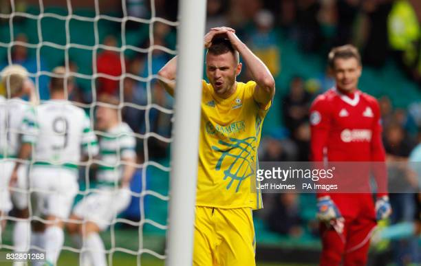FC Astana's Igor Shitov reacts after Celtic's Tom Rogic scores his side's first goal of the game head hands during the UEFA Champions League PlayOff...