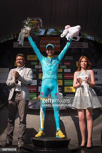 Astana's Italian cyclist Fabio Aru celebrates on the podium after winning the fourth stage of the 68th edition of the Dauphine Criterium cycling race...