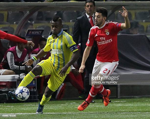 Astana's midfielder from the Central Africa Republic Foxi Kethevoama vies for the ball with Benfica's midfielder Pizzi during the UEFA Champions...