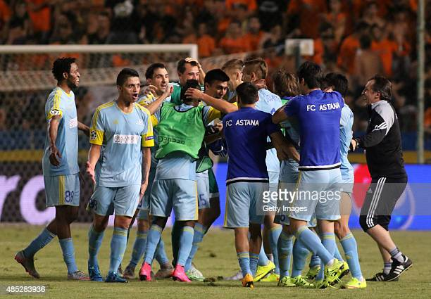 Astana's players celebrate after advancing to the UEFA Champions League group stage after the Qualifying Round Play Off Seconnd Leg match between...