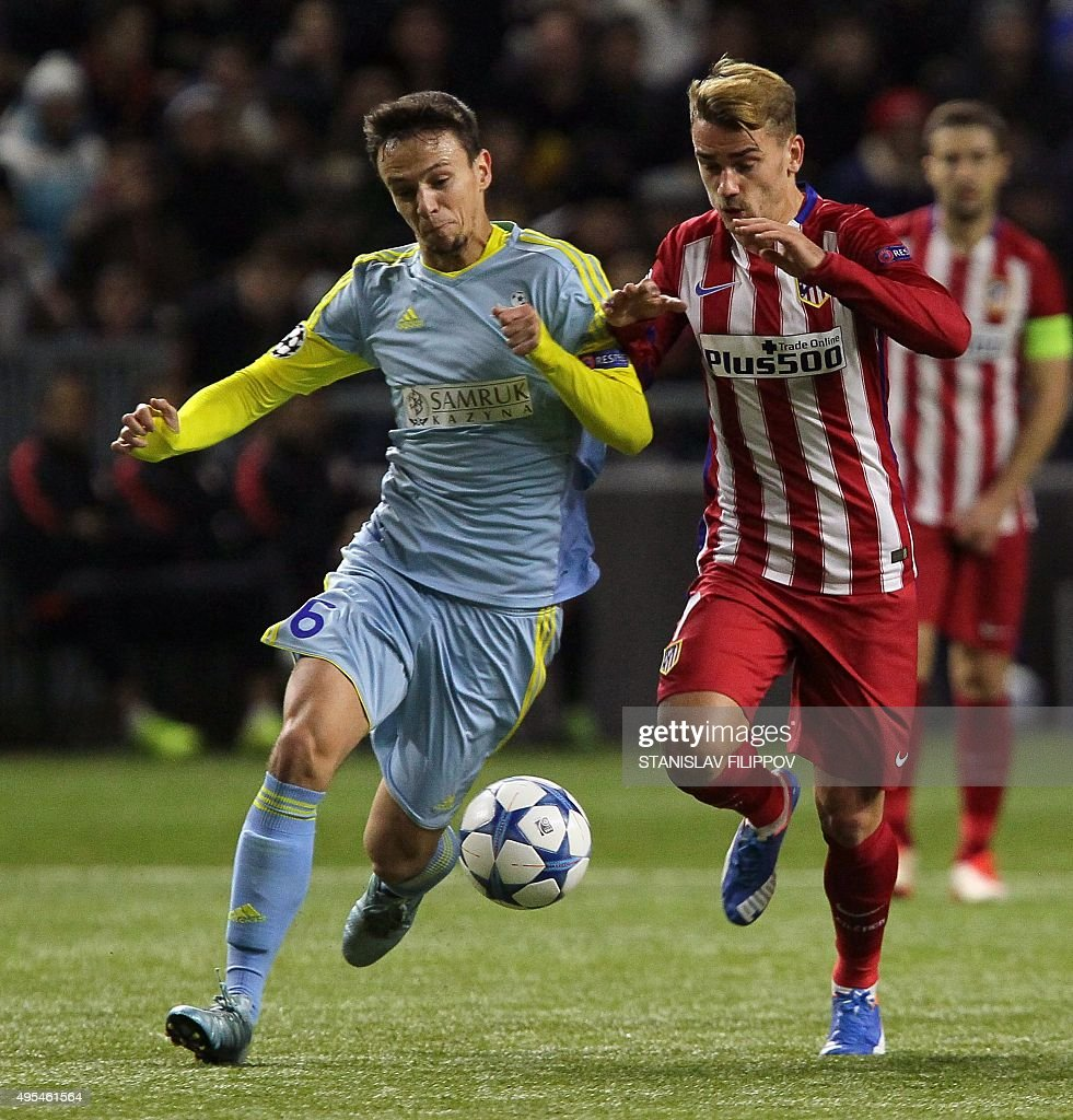 Astana's Serbian midfielder Nemanja Maksimovic vies for the ball with Atletico Madrid's midfielder Saul Niguez during the UEFA Champions League group...
