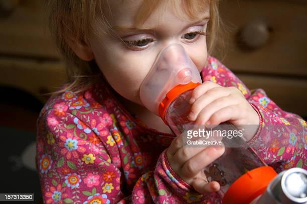 Asthma Girl: Toddler Holds Inhaler After Attack