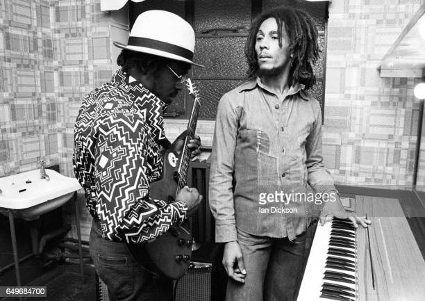 Aston 'Family Man' Barrett and Bob Marley of The Wailers playing guitar and keyboards backstage at the Odeon Birmingham United Kingdom 18 July 1975