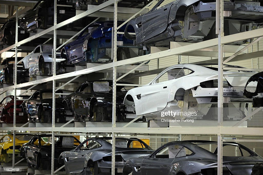 Aston Martin body shells wait to go on the assembly line at the company headquarters and production plant on January 10, 2013 in Gaydon, England. The iconic British brand is celebrating its 100th anniversary. Lionel Martin and Robert Bamford created Bamford & Martin on January 15 1913, which later became Aston Martin in honour of Bamford's wins at the Aston Clinton Hillclimb in Buckinghamshire.