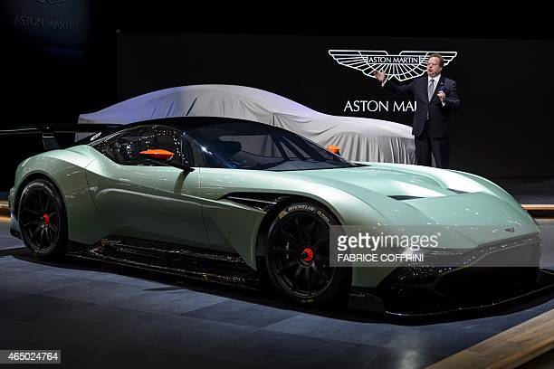 Aston Martin CEO Andy Palmer unveils the new Aston Martin Vulcan model on March 3 2015 at the stand of the British carmaker during the press day of...