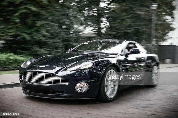 Aston Martin Vanquish sports car driving fast