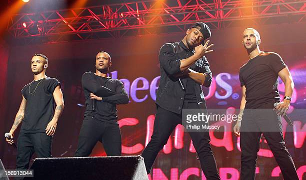 Aston Merrygold Jonathan Gill Oritse Williams and Marvin Humes from JLS perform at the Cheerios Childline concert at 02 on November 24 2012 in Dublin...