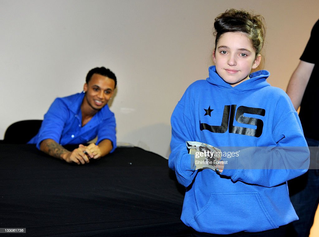 <a gi-track='captionPersonalityLinkClicked' href=/galleries/search?phrase=Aston+Merrygold&family=editorial&specificpeople=5739699 ng-click='$event.stopPropagation()'>Aston Merrygold</a> of JLS meets fans and signs copies of their new album 'Jukebox' at HMV on November 16, 2011 in Manchester, England.