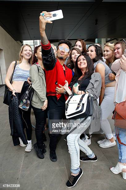 Aston Merrygold poses for pictures with fans at the BBC Radio 1 Studios on June 25 2015 in London England Photo by Alex Huckle/GC Images