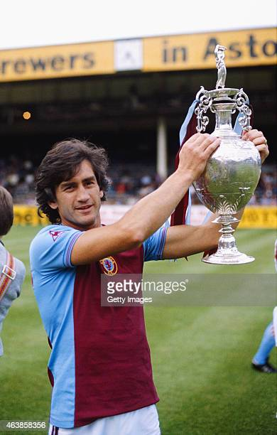 Aston Villa captain Dennis Mortimer holds aloft the Division One League Championship trophy at Villa Park won by Villa in season 19801981 Mortimer...