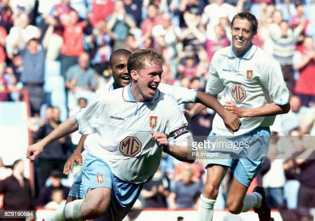 Aston Villa captain Steve Staunton wheels away in delight after scoring Villa's winning goal against FC Zurich watched by team mates Peter Crouch and...