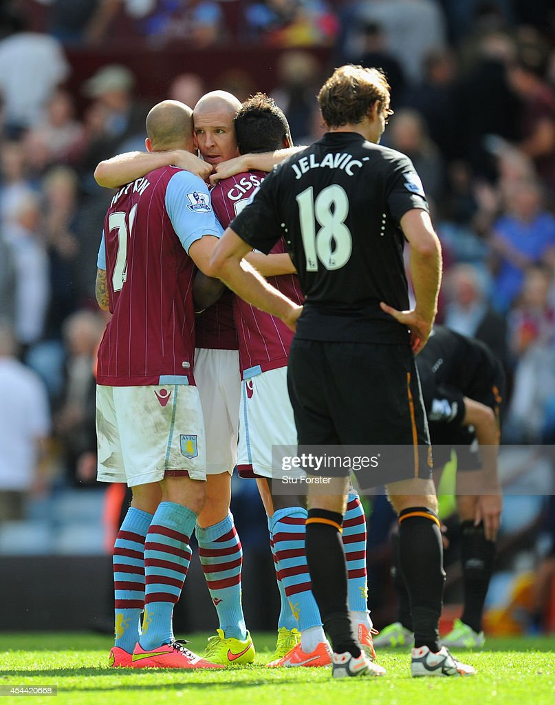 Aston Villa defender Phillippe Senderos (c) and team mates celebrate after the Barclays Premier League match between Aston Villa and Hull City at Villa Park on August 31, 2014 in Birmingham, England.