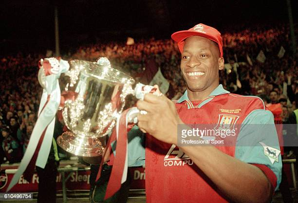 Aston Villa defender Ugo Ehiogu holding the trophy after their victory over Leeds United in the Coca Cola League Cup Final at Wembley stadium in...