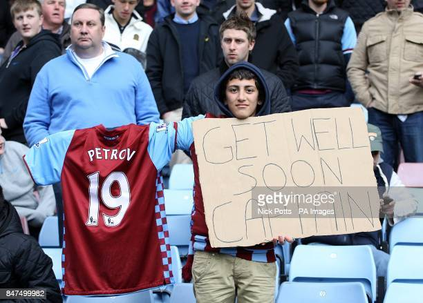 A Aston Villa fan holds a sign saying 'Get Well Soon Captain' in support of Stiliyan Petrov who has been diagnosed with acute leukaemia