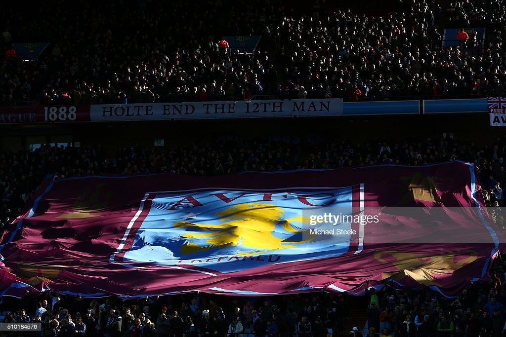 Aston Villa fans unfurl a banner before the Barclays Premier League match between Aston Villa and Liverpool at Villa Park on February 14, 2016 in Birmingham, England.
