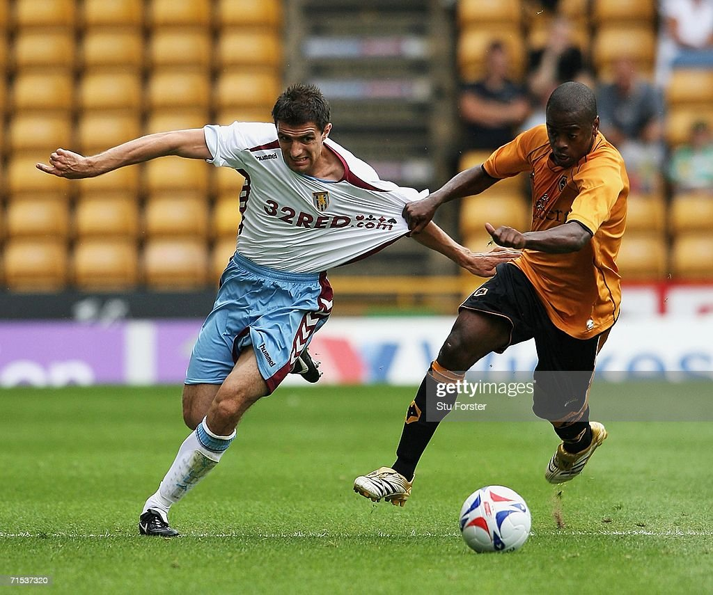 Aston Villa full back Aaron Hughes (l) tussles for the ball with Wolves winger Rohan Ricketts during the Pre-season friendly match between Wolverhampton Wanderers and Aston Villa at Molineux on July 29, 2006 in Wolverhampton, England.