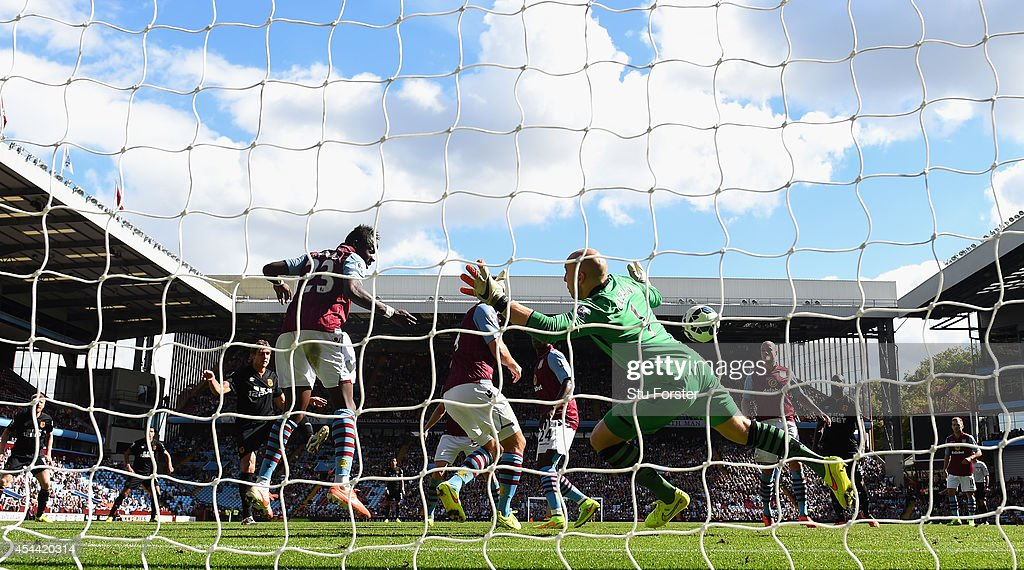 Aston Villa goalkeeper <a gi-track='captionPersonalityLinkClicked' href=/galleries/search?phrase=Brad+Guzan&family=editorial&specificpeople=662127 ng-click='$event.stopPropagation()'>Brad Guzan</a> is beaten for the first Hull goal during the Barclays Premier League match between Aston Villa and Hull City at Villa Park on August 31, 2014 in Birmingham, England.