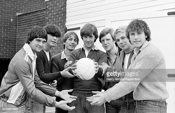 Aston Villa goalkeeper Mark Kendall holding the ball with some of his teammates hoping he doesn't drop it after training at Bodymoor Heath near...