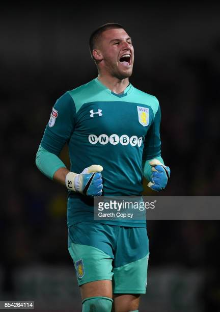 Aston Villa goalkeeper Sam Johnstone celebrates his team's opening goal during the Sky Bet Championship match between Burton Albion and Aston Villa...