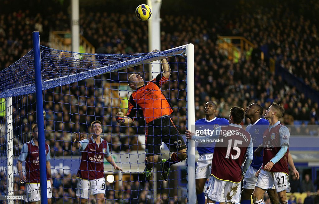 Aston Villa keeper Brad Guzan hangs from the crossbar after making a close range save during the Barclays Premier League match between Everton and Aston Villa at Goodison Park on February 2, 2013 in Liverpool, England.