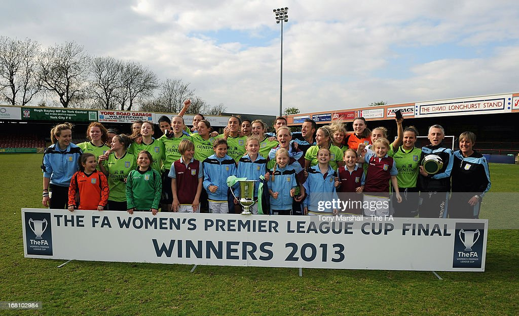 Aston Villa Ladies players celebrate with the trophy after winning the FA Women's Premier League Cup Final between Aston Villa Ladies and Leeds United Ladies at Bootham Crescent Stadium on May 5, 2013 in York, England.