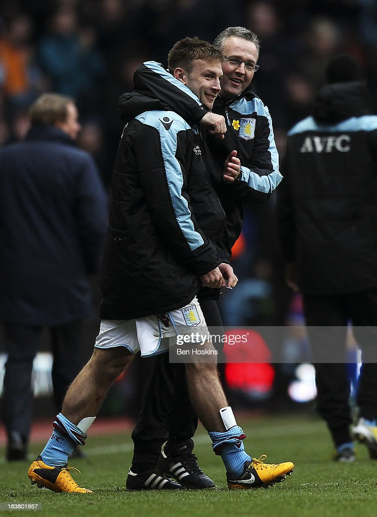 Aston Villa manager celebrates after the final whistle with Andreas Weimann of Aston Villa during the Barclays Premier League match between Aston Villa and Queens Park Rangers at Villa Park on March 16, 2013 in Birmingham, England.