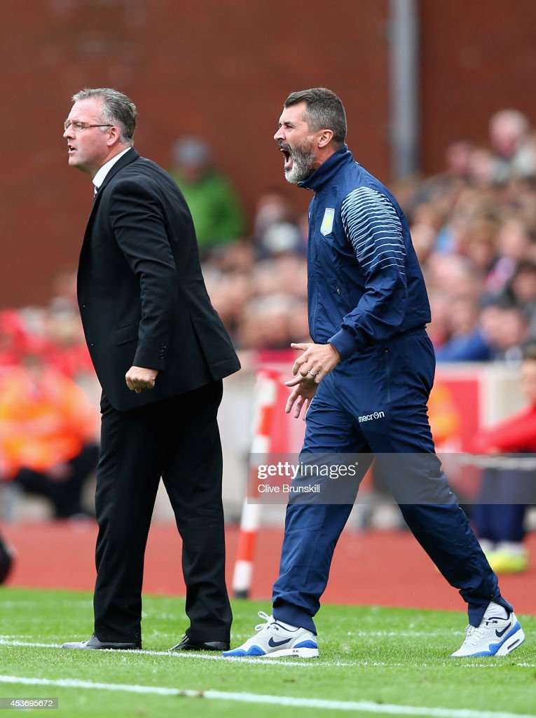 Aston Villa manager Paul Lambert and assistant manager Roy Keane give instructions to their team during the Barclays Premier League match between Stoke City and Aston Villa at Britannia Stadium on August 16, 2014 in Stoke on Trent, England.