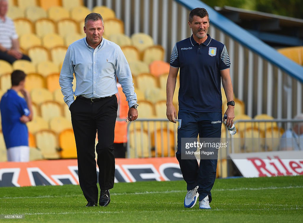 Aston Villa manager Paul Lambert and assistant Roy Keane look on during the pre-season friendly match between Mansfield and Aston Villa at the One Call Stadium on July 17, 2014 in Mansfield, England.