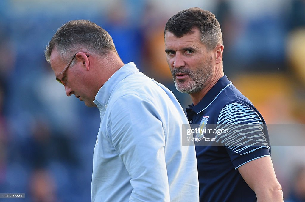 Aston Villa manager Paul Lambert and assistant <a gi-track='captionPersonalityLinkClicked' href=/galleries/search?phrase=Roy+Keane&family=editorial&specificpeople=171835 ng-click='$event.stopPropagation()'>Roy Keane</a> look on during the pre-season friendly match between Mansfield and Aston Villa at the One Call Stadium on July 17, 2014 in Mansfield, England.