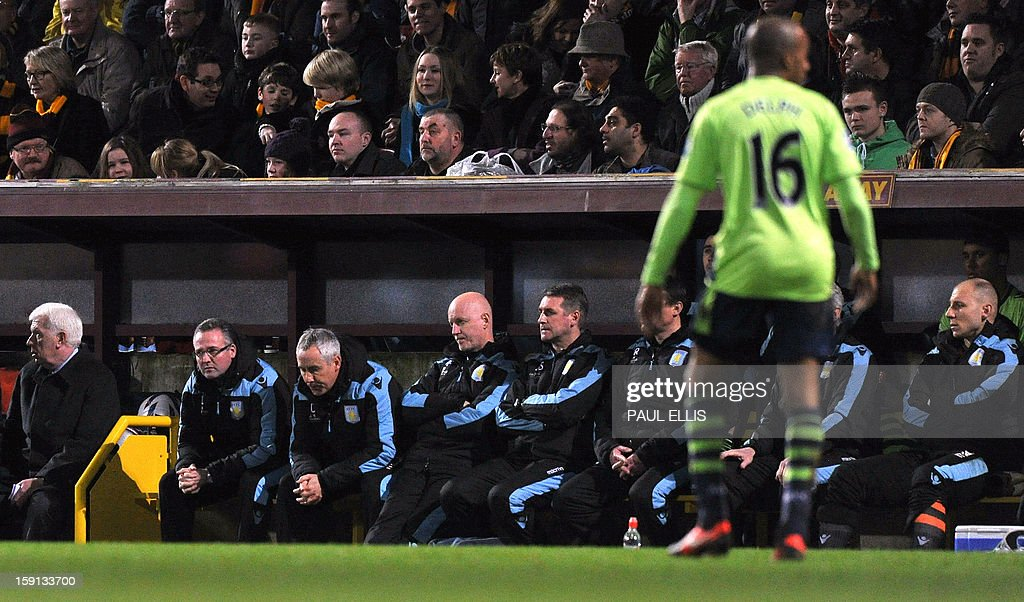 """Aston Villa manager Paul Lambert (2nd L) attends the English League Cup first leg semi-final football match between Bradford City and Aston Villa at The Coral Windows Stadium in Bradford, England, on January 8, 2013. Bradford won the match 3-1. USE. No use with unauthorized audio, video, data, fixture lists, club/league logos or """"live"""" services. Online in-match use limited to 45 images, no video emulation. No use in betting, games or single club/league/player publications."""
