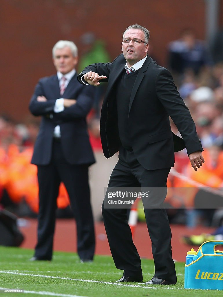Aston Villa manager Paul Lambert gives instructions to his team watched by Stoke City manager <a gi-track='captionPersonalityLinkClicked' href=/galleries/search?phrase=Mark+Hughes+-+Welsh+Soccer+Manager&family=editorial&specificpeople=206223 ng-click='$event.stopPropagation()'>Mark Hughes</a> during the Barclays Premier League match between Stoke City and Aston Villa at Britannia Stadium on August 16, 2014 in Stoke on Trent, England.