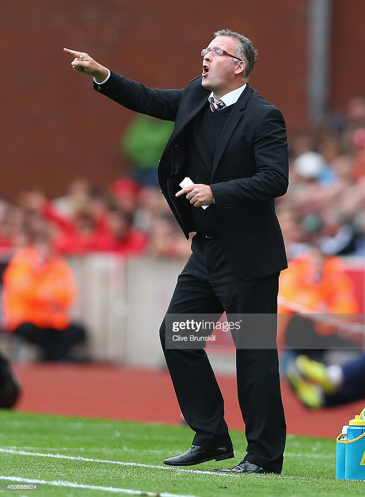 Aston Villa manager Paul Lambert gives instructions to his team during the Barclays Premier League match between Stoke City and Aston Villa at Britannia Stadium on August 16, 2014 in Stoke on Trent, England.